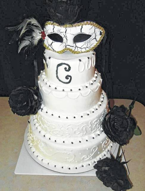 From traditional to unique wedding cakes can fit any design a masquerade theme cake was part of one couples special day junglespirit Image collections