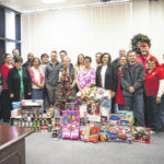 SCC's technology services division donates toys, canned goods