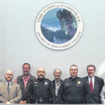 Jonesville police officers promoted during commissioners meeting